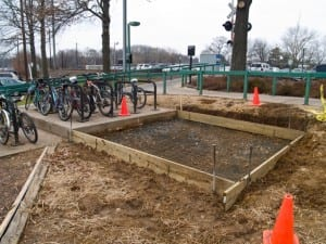 Work on a concrete pad for eight bike racks