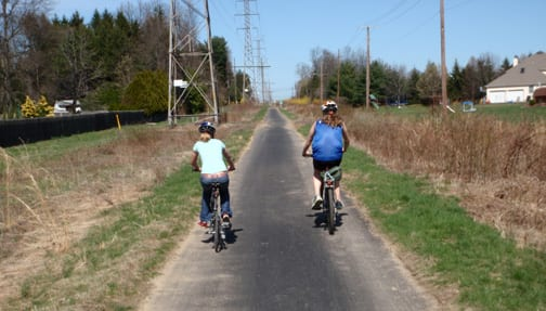 Students pedal along the Trolley Line Trail