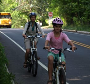 Sonya and Amelia biking to work and school
