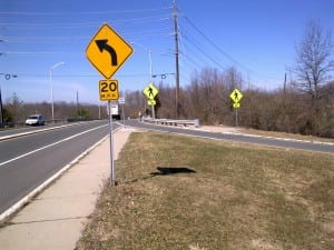 Rt1 NB ramp to Scudders Mill WB sign
